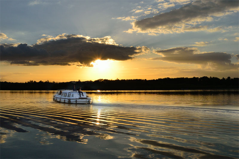 A Boat on Barton Broad at Sunset