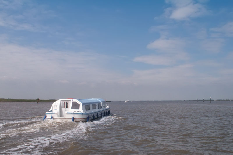 A Cruiser Heading out onto Breydon Water