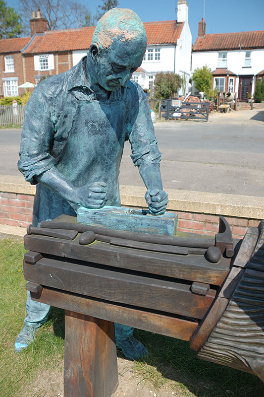 Sculpture of a Boatwright on Reedham Quay