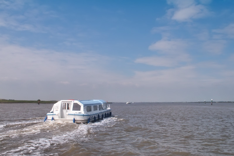 A cruiser crossing Breydon Water